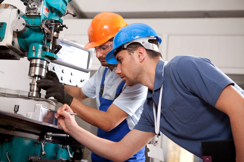 Industrial Workers operating a Drill Press